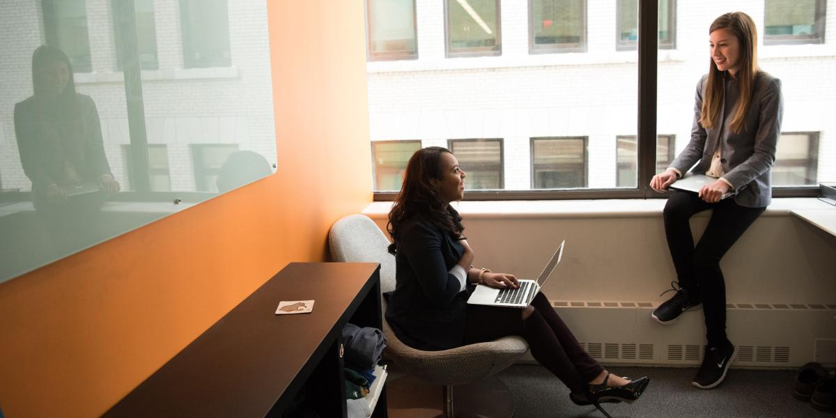 Two people meeting in an office