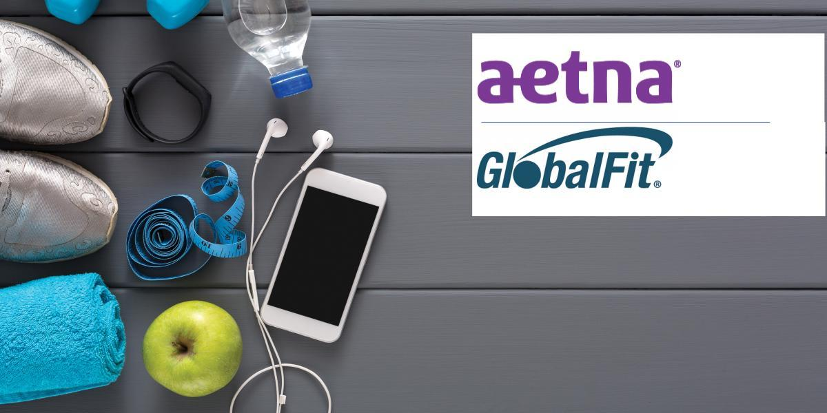 Workout equipment next to Aetna and Global Fit logo